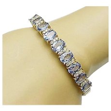 SOLD RL 8-24-17 1995.00 8.00 Carat Tanzanite and .25 Carat Diamond Bangle in 14KT Yellow Gold