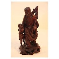 Asian Wood Carving of Man With Child
