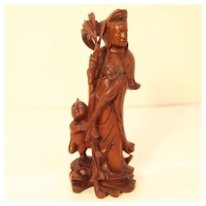 Asian Wood Carving of Quan Yin Protecting Child