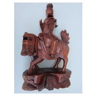 Chinese Wood Carving of A Lady Riding a Mythical Lion