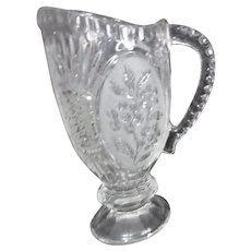 Lead Crystal Pitcher with Pedestal Base and Embossed Floral Pattern