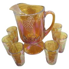 Footed Marigold Carnival Glass Grape & Leaf Pitcher with 11 Juice Glasses