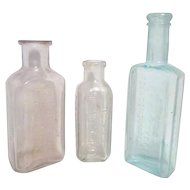 Set of Three Old Home Use Bottles