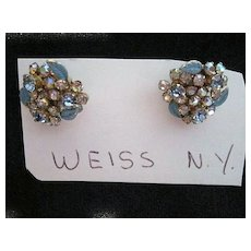 Vintage crystal clip on earrings with blue leaf accent by Weiss NY