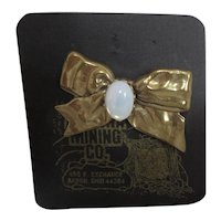 Gold Tone Bow with Opal Cabochon Brooch from Arizona Mining Company