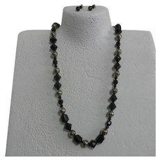 Unsigned Black Glass Bead Necklace with Brass Rose Beads & Clip-on Earrings