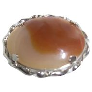 Polished Oval Stone Brooch in Silvertone Setting