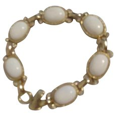 Unsigned Bracelet with White Oval Centerpieces in Goldtone Frames and Rhinestone Accents