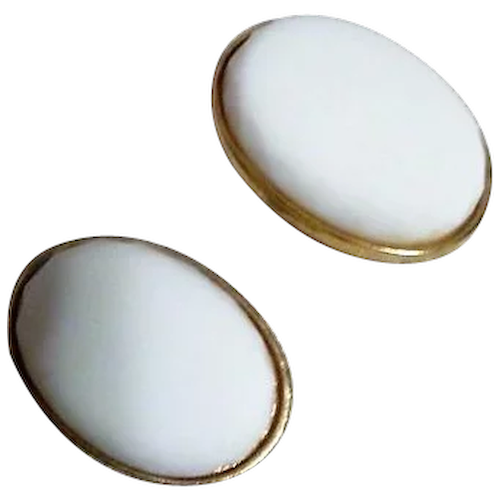 Pair Of Clic White Clip On Earrings From Castlecliff