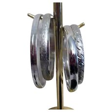 Set of Four Monet Silvertone Stainless Steel Bangles