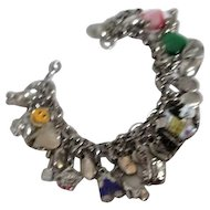 Silvertone Charm Bracelet with Many Assorted Charms