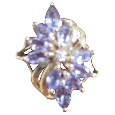 Gold Ring with Tanzanite Stones and Small Diamond in Center