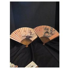Two Vintage Hand Painted Paper Fans with Writing on The Reverse Side