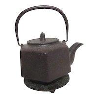 Oriental Metal Tea Pot with Decorated Trivet