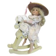Porcelain Doll by Jane Zidjunas Amy on Rocking Horse