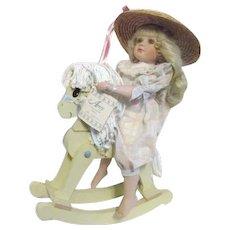 Porcelain Doll by Jane Zidjunas Amy on Rocking Horse