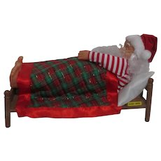 Northpole Productions Snoring Santa Sleeping on Bed