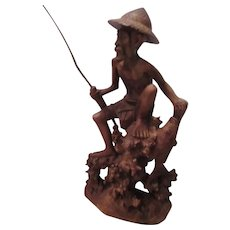 Large Wood Carving of Seated Fisherman with Long Pole and Fish