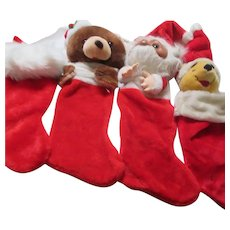 4 Red Plush Christmas Stockings 3 with Heads, One Plain