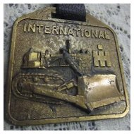 Vintage Watch Fob with International Bulldozer