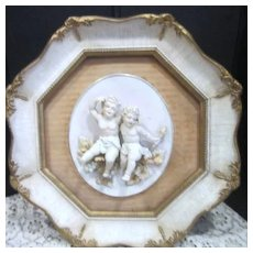 Octagon Framed Two Cherubs on a Branch