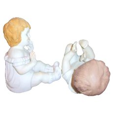 Pair of Ceramic Matt Finished Piano Babies