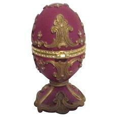 Ornate Footed Mauve Egg with Goldtone Trim Rhinestones Music Box