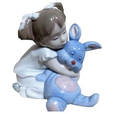Nao Line LLadro Sculpture of Young Girl with Blue Bunny