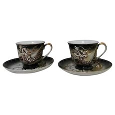Pair of Slip Dragon Demitasse Cups and Saucers with Geisha Inside Cup Bottom