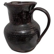 Coiled Structure Brown Pottery Pitcher