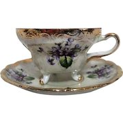 Unmarked Lusterware Footed Coffee Cup and Saucer Violets and Gold Trim