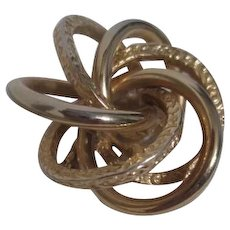 Goldtone Pin/Brooch with Swirling Intertwined Rings