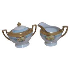 Cream and Sugar Set Signed with Opalescent Background Yellow Roses Gold Trim