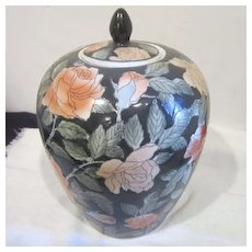 Vintage Chinese Ginger Jar With Rose and Dark Green Background