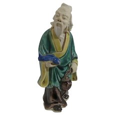 Mudman Figurine with Blue Fish and Lunchpot