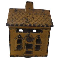 Cast-iron still bank with Yellow Paint, mid 1800's