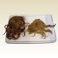 2 wigs, 1 antique, 1 Vintage