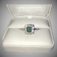 14K White Gold Ring Large Emerald Surrounded by Diamonds