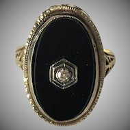Gold and Onyx Oval Ring with Diamond Center