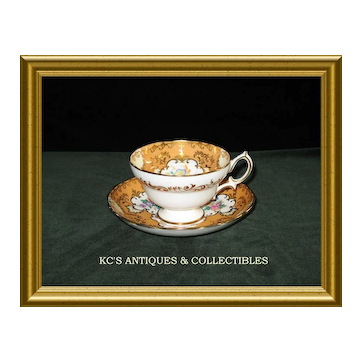 Hammersley Bone China Cup and Saucer in Apricot with Gold trim and medallions filled with floral décor