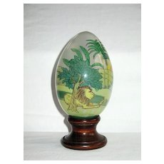 """""""Treasured Visions"""" Reverse (Inside) Painted Glass Egg with Wooden Stand"""
