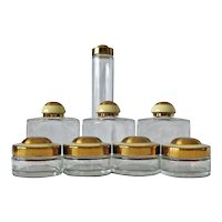 Set of Eight Art Deco Dresser Bottles with Enamel Lids