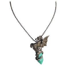Sterling Silver Dragon in Flight Holding A  FauxTurquoise Pendant with Chain