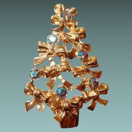 Avon Christmas Tree Brooch with Aurora Borealis Rhinestones Set in Bows