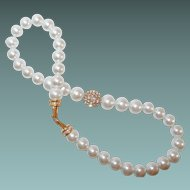 Large Faux Pearl Necklace with Rhinestone Studded Center Bead