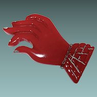 Translucent Cherry Red Carved Bakelite Figural Hand Brooch
