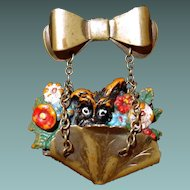 Sweet Flower Basket Pin with Doggie Poking Out Hangs from Bow