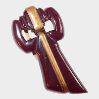 Translucent Red Carved Bakelite Bow Clip Brass Trim