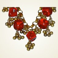 WWII Contoured Translucent Red Plastic and Brass Bead Dangle Necklace