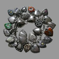 Vintage Twenty-Eight Sterling Heart and Charm Bracelet